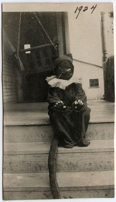 Vintage photograph (1924) of a child dressed as a cat for Halloween