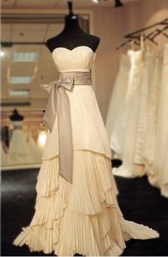 I love the soft elegance of this dress!  Perfect for an evening wedding celebration.