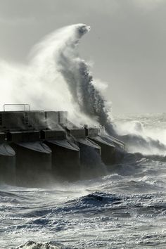 Huge waves crash against the Brighton Marina harbour wall during the St Jude storm (Oct 2013)