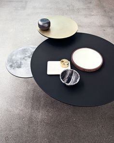 Bolia 2015 collection / Coffee Table /  Eclipse - Linolium /  Black linoleum, Brass/Moon.   Buy it here: http://www.bolia.com/en-us/collection/living/coffee-tables/03-071-10_5145464