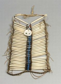 American Indian & Ethnographic Art Location:     Boston   Description:  Plains Hairpipe Breastplate, c. late 19th century, four strips of commercial leather, hide-strung bone hairpipes and multicolored glass trade beads, and a glass bead and shell disc pendant, (minor loss)