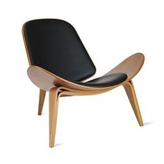 "Wegner's belief that a chair ""should be beautiful from all sides and angles"" is especially evident with his Shell Chair. This comfortable masterpiece is a marvel of grace and beauty"
