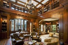 A beautiful library wrapped in mahogany wood has a second floor that wraps around the entire room, with a billiards room adjacent to it. - Imgur