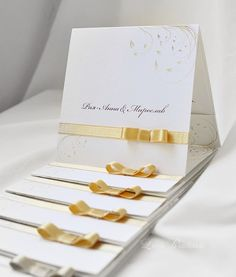Wedding invitations with simple gold floral ornaments