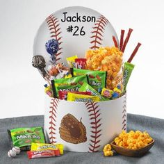 Personalized Baseball Gift Basket from Figi's - Add their name to a box that features their favorite sport – soccer, basketball, baseball, or football. Includes Tootsie Roll Pops®, Mike & Ike®, Laffy Taffy®, Twizzlers®, Dubble Bubble® Gum, Chocolate Sports Balls, and Double Cheddar Popcorn. Winning gifts for your favorite players!