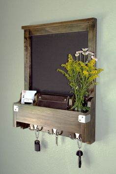 Entryway organizer for your keys, mail, phone and more! No more hunting for the keys while youre trying to run out the door - organize all of your on the go essentials in one convenient place. This is a super stylish way to store everything, get rid of the clutter and add some character to your entry or door way. You can even leave a little message or reminder note on the chalkboard! Constructed of solid wood materials with 3 metal hooks, and metal accents for quality and longevity…