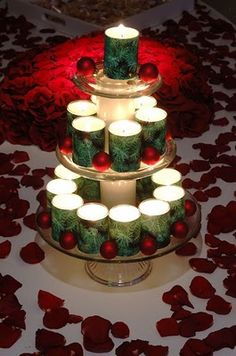 wrap pine tree patterned wrapping paper around votive candle holders and place them on cake stands to form a faux-Christmas tree.