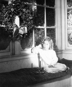 Vintage Christmas Photograph ~ Shirley Temple listening for Santa Claus to arrive. (1936)