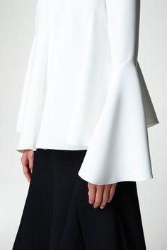 I am all about the increasingly dramatic shift that's happening in the shirt and blouse department. Cascading ruffles are getting longer, deconstructed shirts are taking on more theatrical shapes and sleeves are getting pumped with way more volume.Don't leave the drama at the door, bring on the