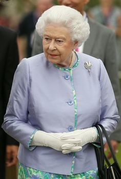 Queen Elizabeth II looks at a dispaly during a visit to the Chelsea Flower Show on press day on May 19, 2014