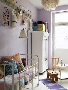 the hooks above the bed...and the bed. - Great kids room.