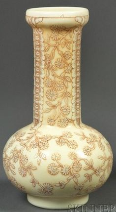 A Webb Cameo glass vase, Art Nouveau, England, raised rim and elongated neck on bulbed simulated ivory vase, cameo-cut in overall blossom and vine motif with elaborate scrolling panels, highlighted with brown patina. Made in England, circa 1880-1920
