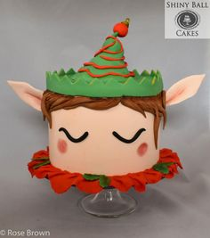 With this elf on the shelf, er, cake stand, everyone will be happy! :) Taking the unicorn cake trend, I created a happy Christmas elf using fondant accents. Christmas Cake Decorations, Christmas Cupcakes, Christmas Sweets, Holiday Cakes, Christmas Elf, Christmas Baking, Christmas Themed Cake, Xmas Cakes, Mini Cakes