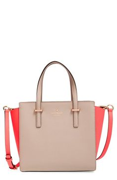 Wowed by the brilliant pop of coral on the sides of this otherwise neutral kate spade new york satchel. It's adorable!
