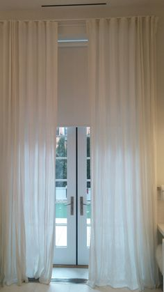 Custom sheer curtains and shades combination by NY City Blinds.