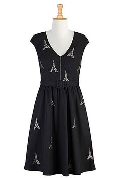 A metal zip front updates the retro appeal of our whimsical embellished poplin dress while a self belt and seamed waist release the full skirt.