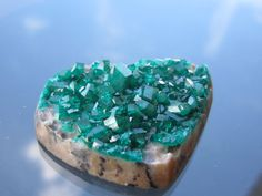A personal favorite from my Etsy shop https://www.etsy.com/listing/460622908/dioptase-cabochon-altyn-tube-kazakhstan