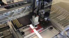 Electronics pick-and-place machine. It can place up to 4000 parts per hour and has a special vision system that allows for non-contact, on-the-fly alignment of SMD (surface mount device) components before placing them onto the PCB.