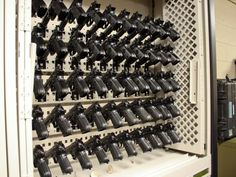 Ammunition Storage in Weapon Racks on Mobile Shelving Military Weapons, Weapons Guns, Guns And Ammo, Ammo Storage, Weapon Storage, Storage Systems, Airsoft, Gun Closet, Reloading Room
