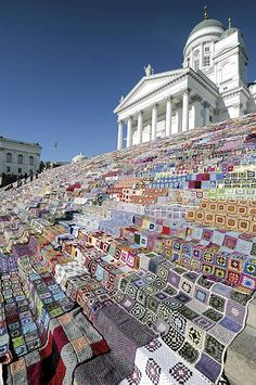 7800 crochet blankets cover the steps of the Helsinki Cathedral in Finland.