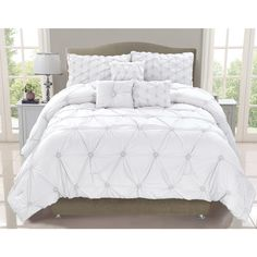 Featuring a contemporary solid color design in white shades, this comforter set will easily upgrade any bedding decor. This polyester set is conveniently machine washable and is available in a queen or king size to complement any room.