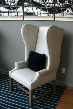 Love this luxurious looking white high back chair
