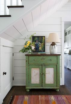 White Shiplap Walls and Distressed Green Cabinet Tucked in Under-stair Cubby A beautifully distressed cabinet perfectly fills the space under the slant of these farmhouse stairs. The green finish pops against the white shiplap walls and warm-tone h Modern Farmhouse, Farmhouse Stairs, White Farmhouse, Farmhouse Plans, Vintage Farmhouse, Farmhouse Style, White Shiplap Wall, Airy Bedroom, Grey Countertops