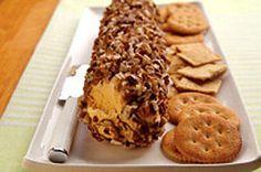 Bûche au fromage et aux pacanes-------------------  Vos convives se régaleront de ce fromage en croûte de pacanes parfumé à la moutarde de Dijon, à la sauce piquante et à l'ail. Une autre recette de hors-d'œuvre qui se cuisine à l'avance.
