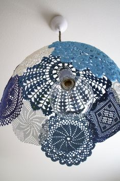 Lace doily light covers. I bought lights too long to fit with the fixtures in our house and just took them off and the exposed lightbulb is there - I wonder if I could do something similar to this and attach it to our ceiling lights?