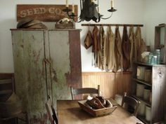 I love the primitive cabinet in this room. Also look at all the crocks on those shelves. Love crocks!