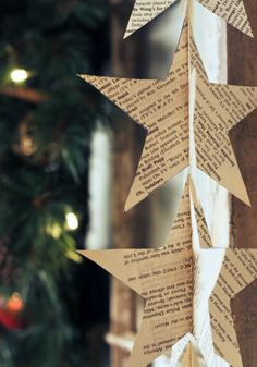 10 Easy DIY Christmas Projects How to Make Book Page Star Garland. I couldn't bring myself to destroy a book to make this, but I could print faux book pages Christmas Music, Winter Christmas, All Things Christmas, Christmas Holidays, Christmas Decorations, Christmas Ornaments, Xmas, Christmas Star, Star Garland