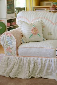 Slipcovers from vintage chenille bedspreads.  Any body know anyone crafty enough to do this, because I am not.