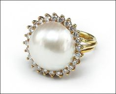 A Mabe Pearl, #Diamond, and 18 Karat Yellow Gold Ring. : Lot 145-7008 #mabepearl #yellowgold #ring