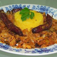 Cooked cabbage with sausages
