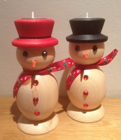 Wood turned snowmen with tea lights in their hats, by Kieran Reynolds