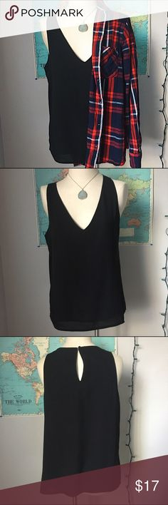 Black Vneck Tank This black v neck tank is a classic piece that is a must have in any wardrobe. It is perfect for layering under sweaters. It is a chiffon looking fabric that has movement when worn. It is lined on the inside so it is not see through. This is in great condition. It is a size L and fits true to size. Forever 21 Tops Tank Tops