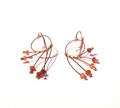 Megan Patrice Riley copper and hessonite earrings with gold earwires. Gallery Lulo.