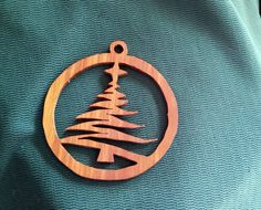 "Thanks for looking!!! This beautiful """"Christmas Tree"" Christmas ornament is handmade, on a scroll saw, with special care.. It is made of 1/8"" cherry wood and weighs appx. 0.2oz and it is 3"" long and 3""wide… it is sanded silky smooth and has a Fromby's lemon oil treatment and a Minwax Clear Aerosol Lacquer finish… This piece will surely stand out on your tree… When you purchase one of my scroll saw ornaments on Etsy, you get a piece hand cut by me on a scroll saw. It is made for you at the…"