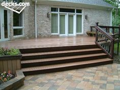 Love the metal and wood railing and the pavers at the bottom of the steps :)