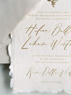 The only thing better than the frayed edges of these wedding invitations is the beautiful gold lettering!   #weddinginvitations #goldlettering #organicinvitations