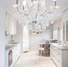 White kitchen. Chandelier. Nutmeg white