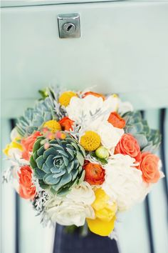 This but with different flowers/colors where they have orange... http://lovewellpost.com/wp-content/uploads/2012/03/green-and-orange-bouquet.jpg