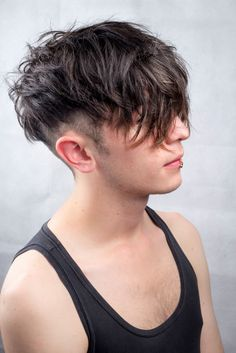 Messy undercut men's hair, textured , natural , black , long
