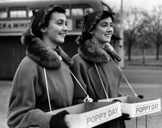A day to remember  7th November 1953: Twin sisters Pamela and Pauline Chamberlain selling Remembrance Day poppies at Leytonstone, London.