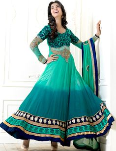 The color range from natural shades looks ravishing.   The dazzling sea green and teal green faux georgette anarkali churidar suit have amazing embroidery patch work is done with resham, zari, stone and lace work.   Beautiful embroidery work on kameez is stunning.   The entire ensemble makes an excellent wear.   Matching santoon churidar and faux chiffon dupatta is available with this suit.   Slight Color variations are possible due to differing screen and photograph resolutions.