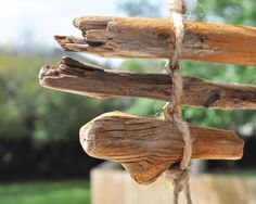 driftwood garland with wing nuts or glass beads