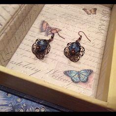 Handmade earrings Handmade flower earrings with light blue beads. One inch long Nameless Creations Jewelry Earrings