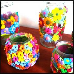 Fimo Flower Jars - very pretty, must try these. The smaller one on the left has holes poked through to the glass so that light will escape if used with a tea light.