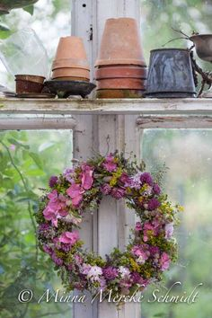 potting shed / beautiful floral wreath / country charm