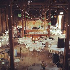 . barn wedding with tissue paper poms